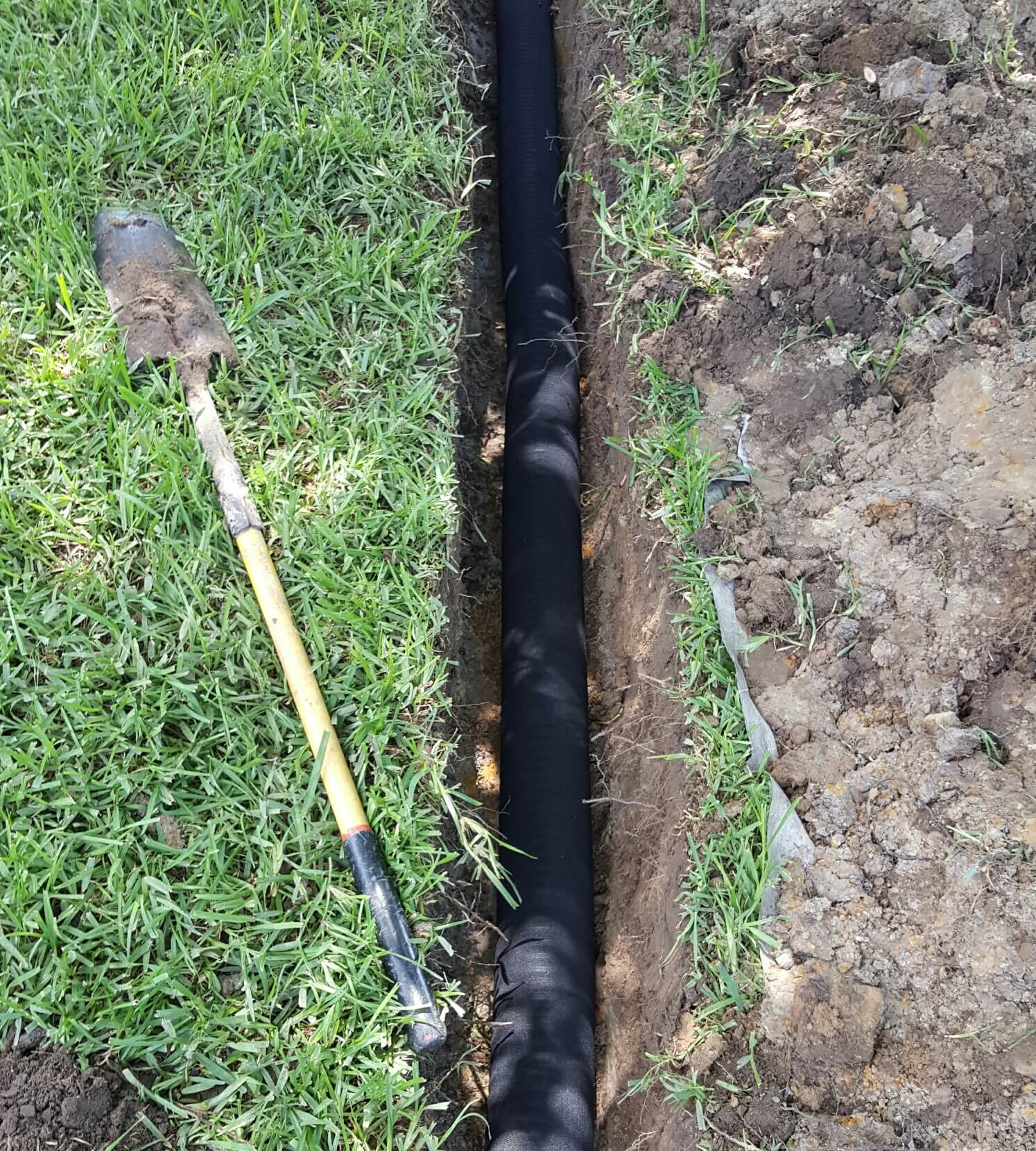 Drainage system colleyville tx french drains surface for Surface drainage system