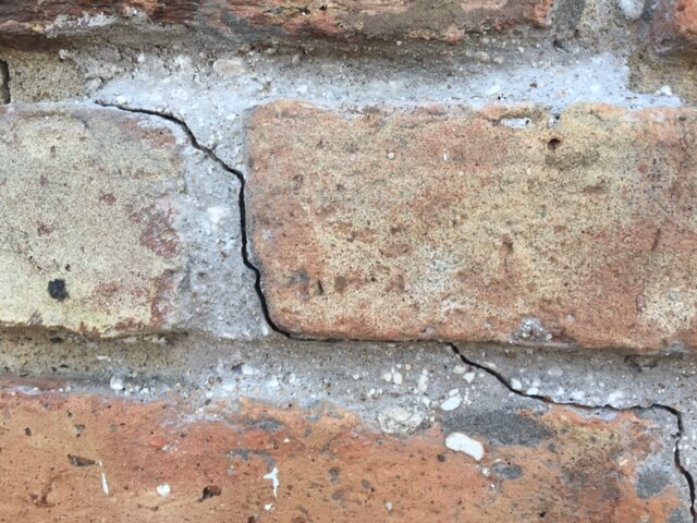 Brick cracks may require foundation repair due to foundation damage.